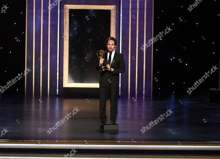 """Alex Lacamoire accepts the award for outstanding music direction for """"Fosse/Verdon"""" for """"Life Is A Cabaret"""" on night one of the Television Academy's 2019 Creative Arts Emmy Awards, at the Microsoft Theater in Los Angeles"""