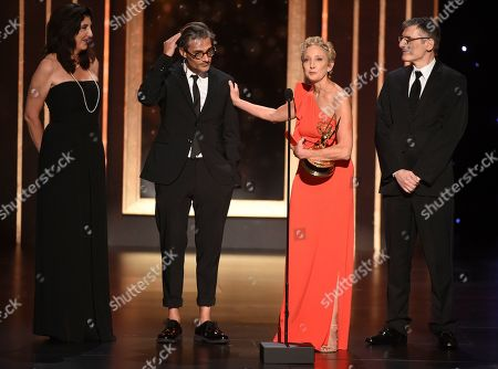"""Victoria Howard, Alberto Mielgo, Jennifer Miller, Gabriele Pennacchioli. EXCLUSIVE - Victoria Howard, and from left, Alberto Mielgo, Jennifer Miller, and Gabriele Pennacchioli accept the award for outstanding short form animated program for """"Love, Death & Robots - The Witness"""" on night one of the Television Academy's 2019 Creative Arts Emmy Awards, at the Microsoft Theater in Los Angeles"""