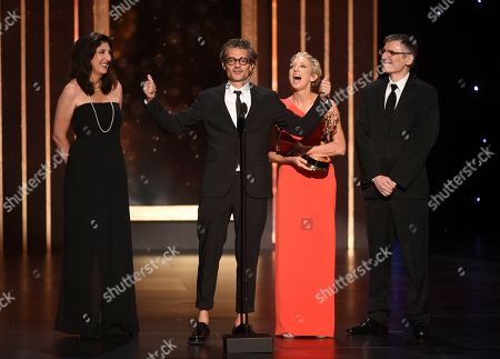 """Stock Picture of Victoria Howard, Alberto Mielgo, Jennifer Miller, Gabriele Pennacchioli. EXCLUSIVE - Victoria Howard, and from left, Alberto Mielgo, Jennifer Miller, and Gabriele Pennacchioli accept the award for outstanding short form animated program for """"Love, Death & Robots - The Witness"""" on night one of the Television Academy's 2019 Creative Arts Emmy Awards, at the Microsoft Theater in Los Angeles"""