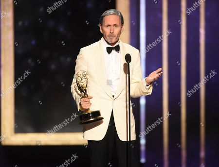 """Stock Photo of EXCLUSIVE - Keith Ian Raywood accepts the award for outstanding production design for variety, reality or competition series for """"Saturday Night Live Host: John Mulaney - Host: Emma Stone"""" on night one of the Television Academy's 2019 Creative Arts Emmy Awards, at the Microsoft Theater in Los Angeles"""