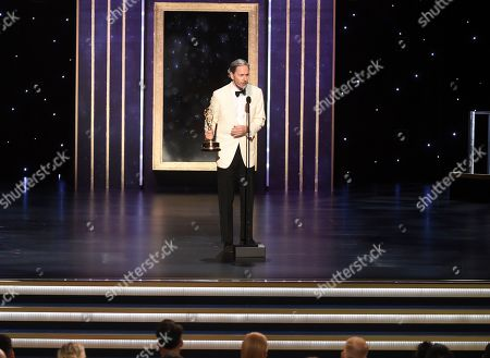 """EXCLUSIVE - Keith Ian Raywood accepts the award for outstanding production design for variety, reality or competition series for """"Saturday Night Live Host: John Mulaney - Host: Emma Stone"""" on night one of the Television Academy's 2019 Creative Arts Emmy Awards, at the Microsoft Theater in Los Angeles"""