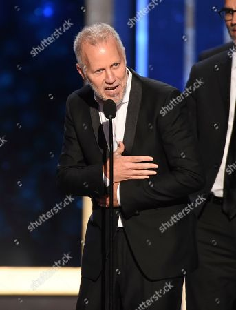 """Christopher Collins accepts the award for outstanding informational series or special for """"Anthony Bourdain: Parts Unknown"""" on night one of the Television Academy's 2019 Creative Arts Emmy Awards, at the Microsoft Theater in Los Angeles"""