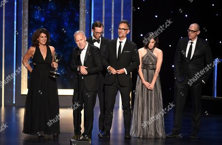 """Christopher Collins, second from left, and the team of """"Anthony Bourdain: Parts Unknown"""" accept the award for outstanding informational series or special on night one of the Television Academy's 2019 Creative Arts Emmy Awards, at the Microsoft Theater in Los Angeles"""