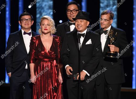 """Bernie Su, second from right, and the team of """"Artificial"""" accept the award for outstanding innovation in interactive media on night one of the Television Academy's 2019 Creative Arts Emmy Awards, at the Microsoft Theater in Los Angeles"""