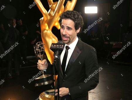 """EXCLUSIVE -Alex Lacamoire poses with the award for outstanding music direction for """"Life is a Cabaret"""" on night one of the Television Academy's 2019 Creative Arts Emmy Awards, at the Microsoft Theater in Los Angeles"""