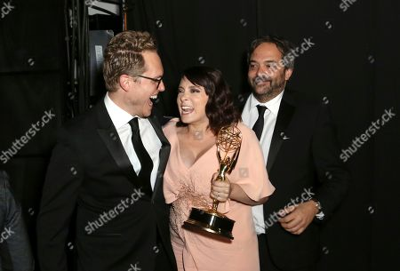 "Jack Dolgen, Rachel Bloom, Adam Schlesinger. Jack Dolgen, from left, Rachel Bloom, and Adam Schlesinger pose backstage with the award for outstanding original music and lyrics for ""Crazy Ex Girlfriend,"" during night one of the Television Academy's 2019 Creative Arts Emmy Awards, at the Microsoft Theater in Los Angeles"
