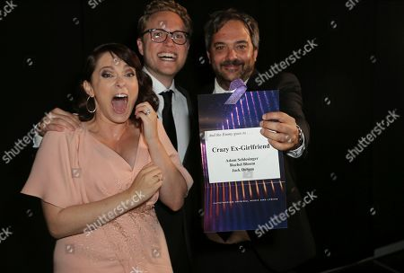 "Jack Dolgen, Rachel Bloom, Adam Schlesinger. Rachel Bloom, from left, Jack Dolgen, and Adam Schlesinger pose backstage for the award for outstanding original music and lyrics for ""Crazy Ex Girlfriend,"" during night one of the Television Academy's 2019 Creative Arts Emmy Awards, at the Microsoft Theater in Los Angeles"