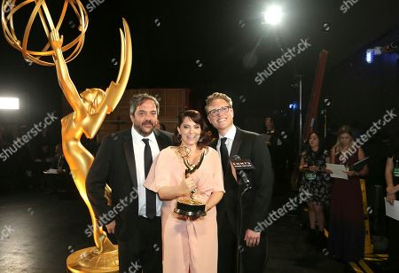 "Jack Dolgen, Rachel Bloom, Adam Schlesinger. Adam Schlesinger, from left, Rachel Bloom, and Jack Dolgen pose backstage with the award for outstanding original music and lyrics for ""Crazy Ex Girlfriend,"" during night one of the Television Academy's 2019 Creative Arts Emmy Awards, at the Microsoft Theater in Los Angeles"