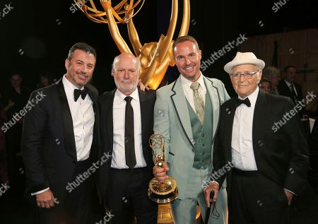 """Stock Photo of Jimmy Kimmel, James Burrows, Brent Miller, Norman Lear. Jimmy Kimmel, from left, James Burrows, Brent Miller, and Norman Lear pose with the award for """"Live in Front of a Studio Audience: Norman Lear's 'All in the Family' and 'The Jeffersons'"""" during night one of the Television Academy's 2019 Creative Arts Emmy Awards, at the Microsoft Theater in Los Angeles"""