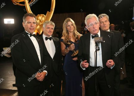 "Keith Scholey, second from right, and the team from of ""Our Planet"" pose backstage with the award for outstanding documentary or nonfiction series on night one of the Television Academy's 2019 Creative Arts Emmy Awards, at the Microsoft Theater in Los Angeles"
