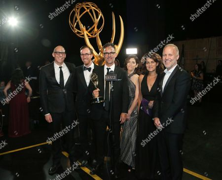 """Stock Image of Christopher Collins, left, and the team of """"Anthony Bourdain: Parts Unknown"""" pose backstage with the award for outstanding informational series or special on night one of the Television Academy's 2019 Creative Arts Emmy Awards, at the Microsoft Theater in Los Angeles"""