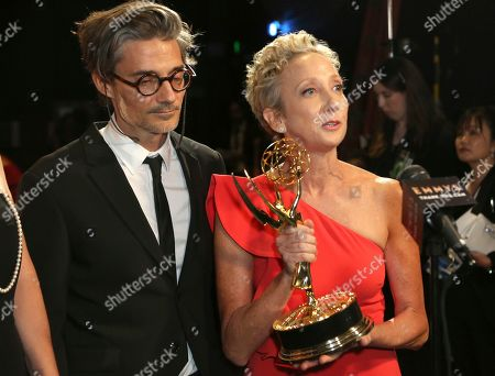 """Stock Photo of Alberto Mielgo, Jennifer Miller. EXCLUSIVE - Alberto Mielgo, left, and Jennifer Miller are seen backstage with the award for outstanding short form animated program for """"Love, Death & Robots - The Witness"""" on night one of the Television Academy's 2019 Creative Arts Emmy Awards, at the Microsoft Theater in Los Angeles"""