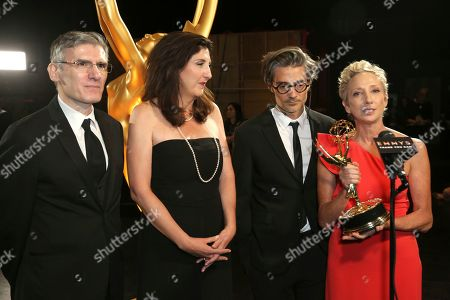 """Stock Image of Gabriele Pennacchioli, Victoria Howard, Alberto Mielgo, Jennifer Miller. EXCLUSIVE - Gabriele Pennacchioli, Victoria Howard, Alberto Mielgo, and Jennifer Miller are seen backstage with the award for outstanding short form animated program for """"Love, Death & Robots - The Witness"""" on night one of the Television Academy's 2019 Creative Arts Emmy Awards, at the Microsoft Theater in Los Angeles"""