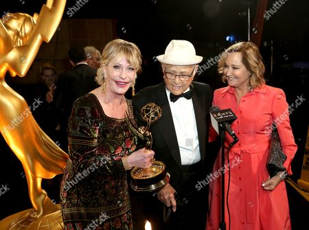 """Lyn Lear, Normal Lear, Maggie Lear. Lyn Lear, and from left, Normal Lear, and Maggie Lear are seen backstage with the award for outstanding variety special (live) for """"Live in Front of a Studio Audience: Norman Lear's 'All in the Family' and 'The Jeffersons'"""" on night one of the Television Academy's 2019 Creative Arts Emmy Awards, at the Microsoft Theater in Los Angeles"""