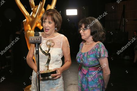 Betsy West, Julie Cohen. Betsy West, left, and Julie Cohen pose backstage with the award for Exceptional Merit in Documentary Filmmaking during night one of the Television Academy's 2019 Creative Arts Emmy Awards, at the Microsoft Theater in Los Angeles