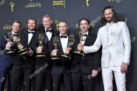 """Mike Cheeseman, Daniel Day, David Lovejoy and Ben Mullen, John Griber, Benji Lanpher. Mike Cheeseman, from left, Daniel Day, David Lovejoy and Ben Mullen, John Griber, Benji Lanpher pose with their awards for outstanding cinematography for a reality program for """"Life Below Zero"""" in the press room with their awards for on night one of the Creative Arts Emmy Awards, at the Microsoft Theater in Los Angeles"""