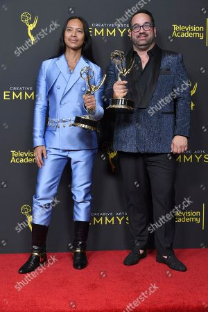 "Zaldy Goco, Art Conn. Zaldy Goco, left, and Art Conn pose in the press room with their awards for outstanding costumes for variety, nonfiction or reality programming for ""RuPaul's Drag Race"" on night one of the Creative Arts Emmy Awards, at the Microsoft Theater in Los Angeles"