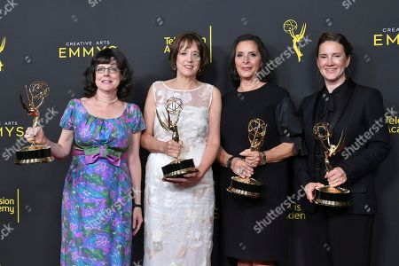"""Stock Photo of Julie Cohen, Betsy West, Amy Entelis, Courtney Sexton. Julie Cohen, from left, Betsy West, Amy Entelis and Courtney Sexton pose in the press room with their awards for exceptional merit in documentary filmmaking for """"RBG"""" on night one of the Creative Arts Emmy Awards, at the Microsoft Theater in Los Angeles"""