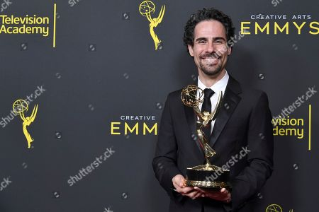"""Alex Lacamoire poses in the press room with the award outstanding music direction for """"Fosse/Verdon"""" on night one of the Creative Arts Emmy Awards, at the Microsoft Theater in Los Angeles"""