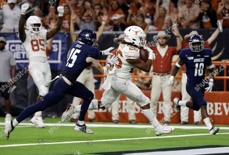 Keaontay Ingram, Andrew Bird. Texas running back Keaontay Ingram (26) leaps across the goal line past Rice cornerback Andrew Bird (15) to score a touchdown during the second half of an NCAA college football game, in Houston