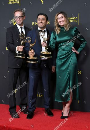 """Sam Bisbee, Rudy Valdez, Theodora Dunlap. Sam Bisbee, from left, Rudy Valdez, and Theodora Dunlap pose in the press room with their awards for exceptional merit in documentary filmmaking for """"The Sentence"""" on night one of the Creative Arts Emmy Awards, at the Microsoft Theater in Los Angeles"""