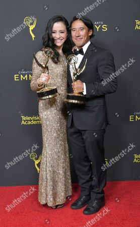 "Elizabeth Chai Vasarhelyi, Jimmy Chin. Elizabeth Chai Vasarhelyi, left, and Jimmy Chin pose in the press room with their awards for outstanding directing for a documentary / nonfiction program for ""Free Solo"" on night one of the Creative Arts Emmy Awards, at the Microsoft Theater in Los Angeles"