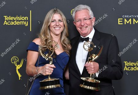 "Sophie Lanfear and Keith Scholey pose in the press room with their awards for outstanding documentary or nonfiction series for ""Our Planet"" on night one of the Creative Arts Emmy Awards, at the Microsoft Theater in Los Angeles"