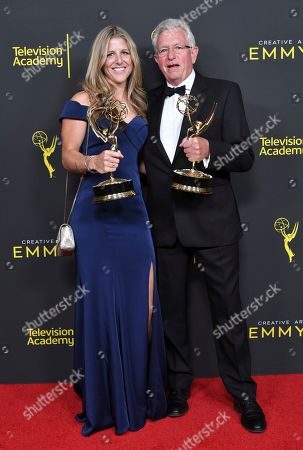 "Stock Photo of Sophie Lanfear and Keith Scholey pose in the press room with their awards for outstanding documentary or nonfiction series for ""Our Planet"" on night one of the Creative Arts Emmy Awards, at the Microsoft Theater in Los Angeles"