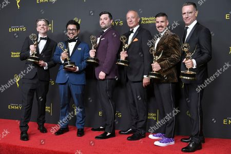 """Stock Picture of Joseph DeShano, Matthew Miller, Ryan Taylor, Carlos Gamarra, Iain Tibbles, Tony Zajkowski. Joseph DeShano, from left, Matthew Miller, Ryan Taylor, Carlos Gamarra, Iain Tibbles, and Tony Zajkowski pose in the press room with their award for outstanding picture editing for a structured reality or competition program for """"Queer Eye"""" on night one of the Creative Arts Emmy Awards, at the Microsoft Theater in Los Angeles"""