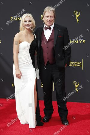 Stock Image of Mandy Hansen and Sig Hansen arrives on the red carpet for the 2019 Creative Arts Emmy Awards at the Microsoft Theater in Los Angeles, California, USA, 14 September 2019. The Creative Arts Emmy Awards honor excellence in Television technical categories such as makeup, casting direction, costume design, editing and cinematography. The 71st Primetime Emmy Awards Ceremony will take place on 22 September 2019.