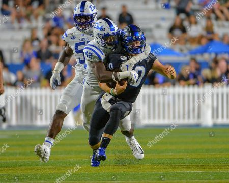 Duke linebacker, Shaka Heyward (42), pulls down MTSU quarterback, Asher O'Hara (10) as he runs the ball, during the NCAA football game between the Duke Blue Devils and the Middle Tennessee Blue Raiders at Johnny Floyd Stadium in Murfreesboro, TN. Credit: Kevin Langley/Sports South Media/CSM