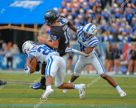 Stock Image of Duke safety, Jalen Alexander (30), pulls down MTSU quarterback, Asher O'Hara (10), during the NCAA football game between the Duke Blue Devils and the Middle Tennessee Blue Raiders at Johnny Floyd Stadium in Murfreesboro, TN. Credit: Kevin Langley/Sports South Media/CSM