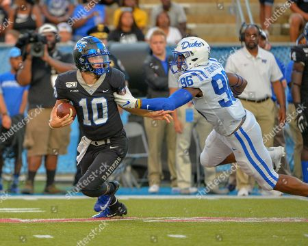 Stock Photo of Duke defensive end, Chris Rumph II (96), chases MTSU quarterback, Asher O'Hara (10), during the NCAA football game between the Duke Blue Devils and the Middle Tennessee Blue Raiders at Johnny Floyd Stadium in Murfreesboro, TN. Credit: Kevin Langley/Sports South Media/CSM