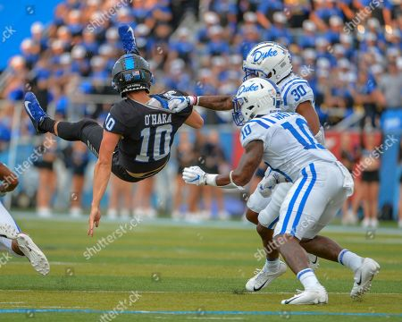 Duke safety, Jalen Alexander (30), pulls down MTSU quarterback, Asher O'Hara (10), during the NCAA football game between the Duke Blue Devils and the Middle Tennessee Blue Raiders at Johnny Floyd Stadium in Murfreesboro, TN. Credit: Kevin Langley/Sports South Media/CSM