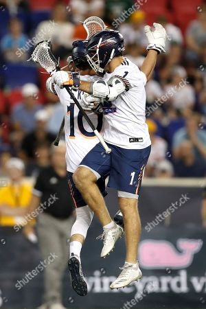 Stock Photo of Archers' Stephen Kelly (10) and Archers' Marcus Holman (1) celebrate a goal against the Chrome during a Premier Lacrosse League game on in Harrison, N.J