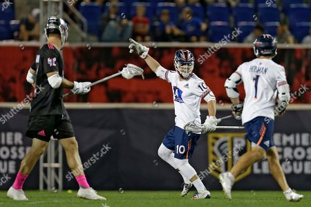 Archers' Stephen Kelly (10), celebrates a goal, with Marcus Holman (1) against the Chrome during a Premier Lacrosse League game on in Harrison, N.J