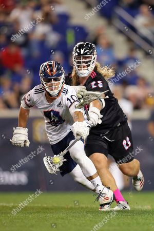Stock Image of Archers' Stephen Kelly (10), is pursued by Chrome's Connor Farrell (25), during a Premier Lacrosse League game on in Harrison, N.J