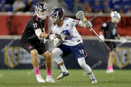 Archers' Stephen Kelly (10), is defended by Chrome's Joel White (11), during a Premier Lacrosse League game on in Harrison, N.J