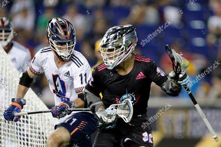 Archers' Matt McMahon (11), defends Chrome's Jordan Wolf (32), during a Premier Lacrosse League game on in Harrison, N.J