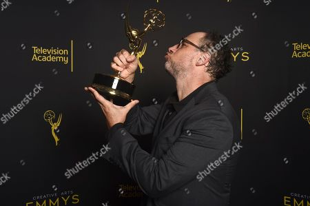 """Stock Image of Matt Selman of """"The Simpsons"""" poses with the award for outstanding animated program for """"Mad About the Toy"""" on night one of the Television Academy's 2019 Creative Arts Emmy Awards, at the Microsoft Theater in Los Angeles"""