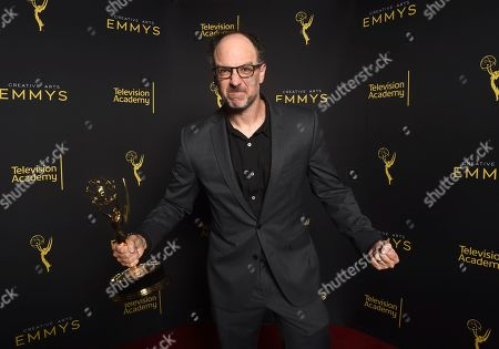 """Matt Selman of """"The Simpsons"""" poses with the award for outstanding animated program for """"Mad About the Toy"""" on night one of the Television Academy's 2019 Creative Arts Emmy Awards, at the Microsoft Theater in Los Angeles"""