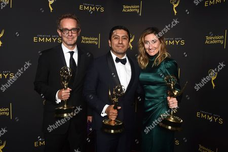 """Stock Photo of Sam Bisbee, Rudy Valdez, Theodora Dunlap. Sam Bisbee, from left, Rudy Valdez and Theodora Dunlap, winners of the award for exceptional merit in documentary filmmaking for """"The Sentence"""" pose for a portrait on night one of the Television Academy's 2019 Creative Arts Emmy Awards, at the Microsoft Theater in Los Angeles"""