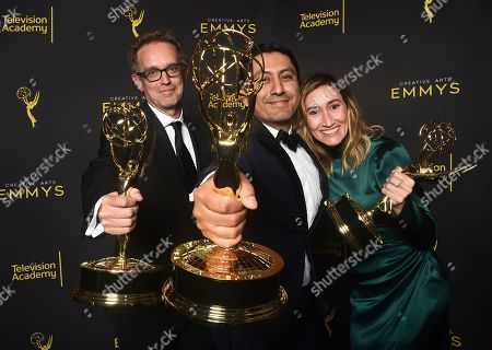 """Sam Bisbee, Rudy Valdez, Theodora Dunlap. Sam Bisbee, from left, Rudy Valdez and Theodora Dunlap, winners of the award for exceptional merit in documentary filmmaking for """"The Sentence"""" pose for a portrait on night one of the Television Academy's 2019 Creative Arts Emmy Awards, at the Microsoft Theater in Los Angeles"""