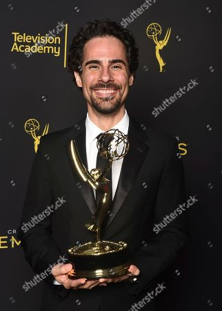 """Alex Lacamoire, winner of the award for Music Direction for Fosse/Verdon for """"Life is a Cabaret"""" poses for a portrait on night one of the Television Academy's 2019 Creative Arts Emmy Awards, at the Microsoft Theater in Los Angeles"""