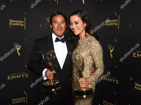 "Jimmy Chin, Elizabeth Chai Vasarhelyi. Jimmy Chin, left, and Elizabeth Chai Vasarhelyi, winners of the award for outstanding cinematography for a nonfiction program for ""Free Solo"", pose for a portrait on night one of the Television Academy's 2019 Creative Arts Emmy Awards, at the Microsoft Theater in Los Angeles"