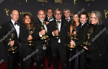 """Stock Photo of Michael Williams, Rob Eric, Jennifer Lane, Jordana Hochman, David George, Adam Sher, David Eilenberg, Rachelle Mendez, Mark Bracero. The Team from """"Queer Eye"""" poses with the award for outstanding structured reality program for """"Queer Eye"""" on night one of the Television Academy's 2019 Creative Arts Emmy Awards, at the Microsoft Theater in Los Angeles"""
