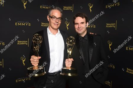 """Marco Beltrami, Brandon Roberts. Marco Beltrami, left, and Brandon Roberts winners of award for outstanding music composition for a documentary for """"Free Solo"""" pose for a portrait on night one of the Television Academy's 2019 Creative Arts Emmy Awards, at the Microsoft Theater in Los Angeles"""
