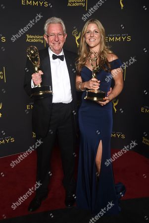 "Sophie Lanfear, Keith Scholey. Keith Scholey, left, and Sophie Lanfear poses with the award for outstanding documentary or nonfiction series for ""Our Planet"" on night one of the Television Academy's 2019 Creative Arts Emmy Awards, at the Microsoft Theater in Los Angeles"