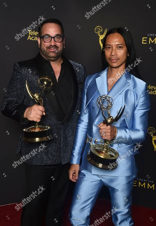 "Zaldy Goco, Art Conn. Art Conn, left, and Zaldy Goco of ""Rupaul's Drag Race"" pose with the award for outstanding costumes for variety, nonfiction or reality programming for ""Trump The Musical"" on night one of the Television Academy's 2019 Creative Arts Emmy Awards, at the Microsoft Theater in Los Angeles"