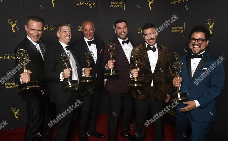 """Stock Photo of Tony Zajkowski, Joseph DeShano, Iain Tibbles, Matthew Miller, Ryan Taylor, Carlos Gamarra. Tony Zajkowski, from left, Joseph DeShano, Iain Tibbles, Matthew Miller, Ryan Taylor and Carlos Gamarra winners of the award for outstanding picture editing for a structured reality or competition program for """"Queer Eye"""", pose for a portrait on night one of the Television Academy's 2019 Creative Arts Emmy Awards, at the Microsoft Theater in Los Angeles"""